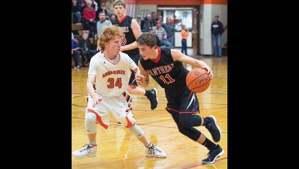 Panther senior Rylan Gauthier takes on Husky junior Jake Branger.  Gauthier led Park City with 16 points.