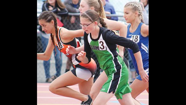 Cougar Amber LeBrun competes in the 800-meter race in Butte.  She broke the school record and finished in third.