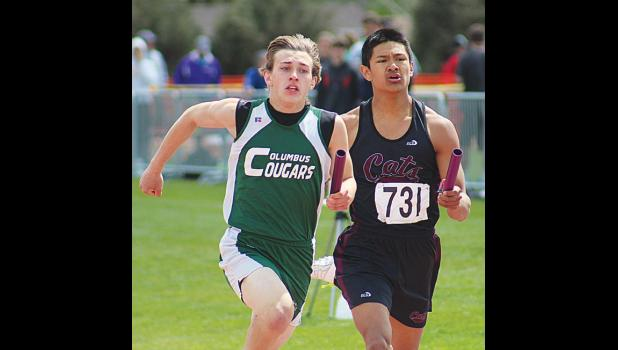 Connor Goddard battles it out in a relay.