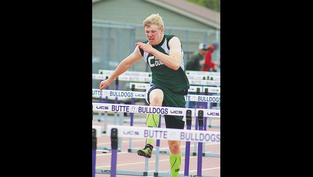 Columbus Cougar Michael Jacobson tackles the 110 hurdles during the state meet in Butte.  Jacobson finished in 16th place.