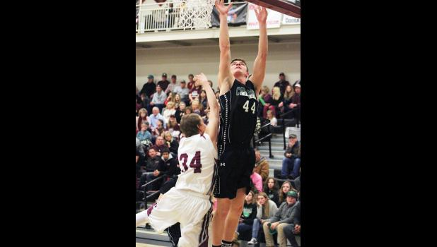 Columbus sophomore Tommy Campbell puts up a shot against the Roundup Panthers last Friday during the 4B District Tournament.