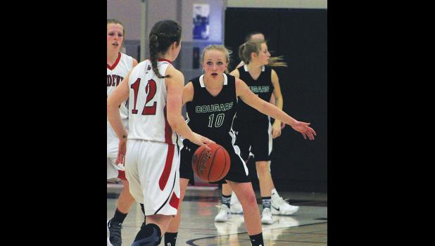 Columbus sophomore Brenna Rouane plays tough defense against Huntley.
