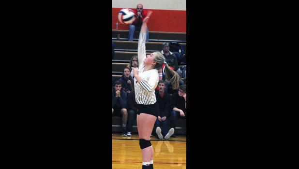 Park City Panther Andee Baker goes for a kill against Plenty Coups.
