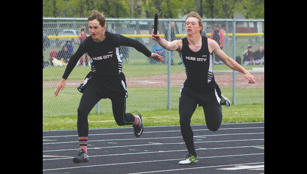 Jordan Neves hands the baton off to Rylan Gauthier during the 400 relay.  The team won the event.