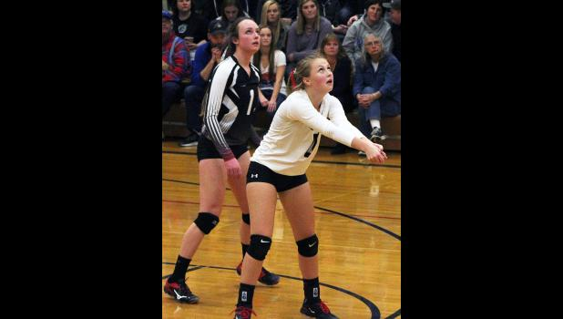 Panther libero Megan Flemmer bumps the ball as senior Brittany Frank watches the play develop.