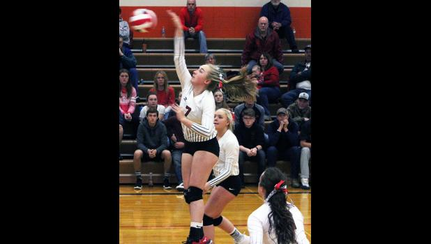 Panther Andee Baker hits the ball.