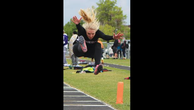Park City's Rayna Laakso flies through the air during long jump -- she finished third.