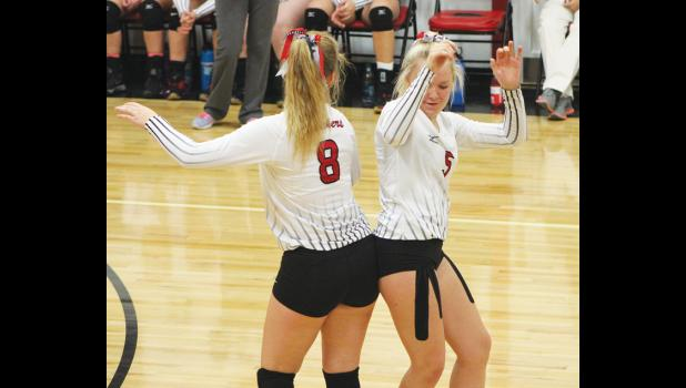 Park City Panthers Kasidy Robbins and Blakely Verke do their pre-serve ritual  on Thursday.