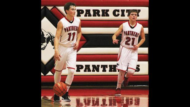 Park City's Garrett McMillen (right) heads down the court after inbounding the ball to Rylan Gauthier (left).