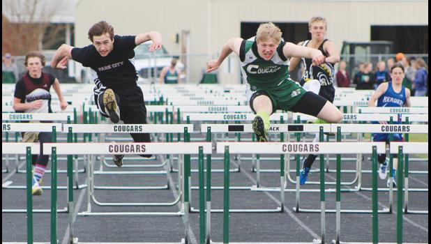 Cougar Michael Jacobson competes in the 110 hurdles, an event he won. To his left is a Park City competitor.