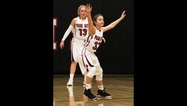 Panther sophomore Alexis Goldy (front) and senior Blakely Verke (back) set up on defense last Thursday.