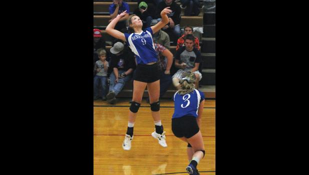 RPR's Carlee Blodgett reaches back to spike the ball as Jocelyn Ott readies for backup.