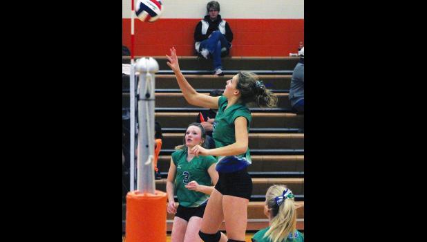 Renegade sophomore Carlee Blodgett tips the ball over the net last Thursday.
