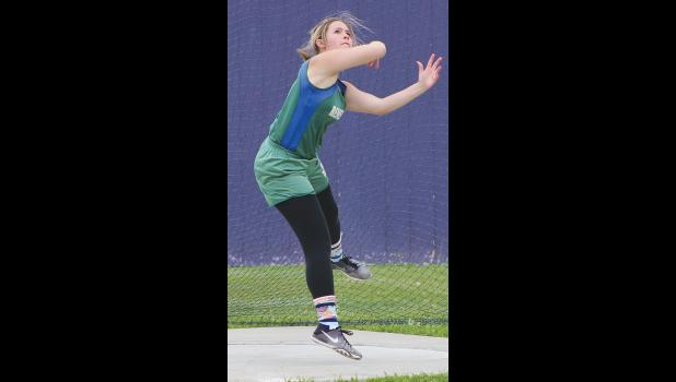 Renegade Nynah Bryant throws the discus.  Bryant finished in fifth place.