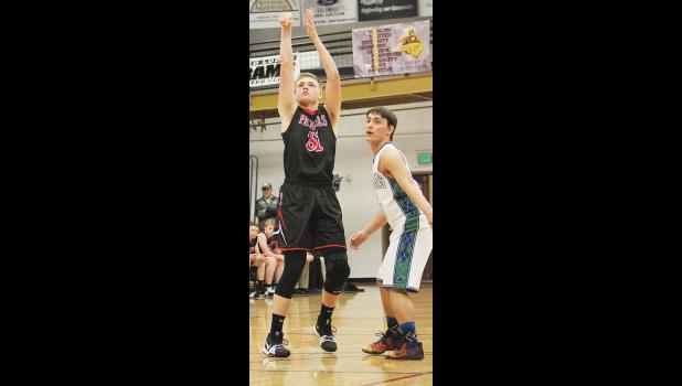 Park City senior Talon Johnstone takes a shot as RPR senior Derek Peterson looks on.