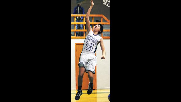 RPR sophomore Daynon Pettyjohn goes for a layup in the Renegades' win over the Roberts Rockets last Friday.