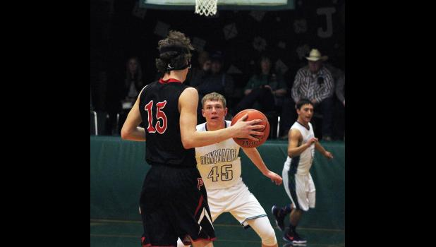 RPR's Dylan Blodgett guards Park City's Connor McNeil as he takes the ball down the court.