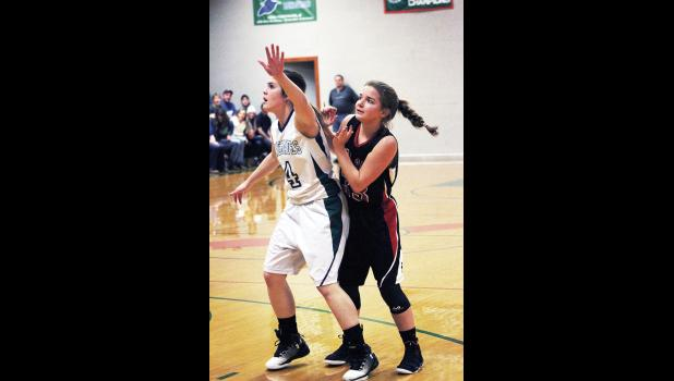 RPR's Nynah Bryant boxes out Park City's Alexis Goldy as she watches to see if her shot went in the hoop.