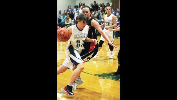 Renegade Hannah Beach drives toward the basket around Panther Brittany Frank.