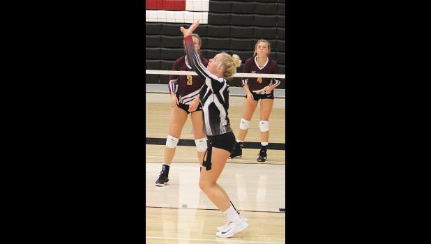 Junior Blakely Verke sets the ball.