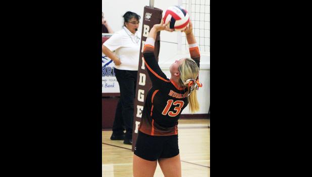 Emma LaMoure sets the ball last Thursday in Bridger.