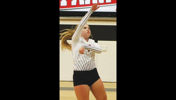 Park City's Arica Hedges goes for a kill against Fromberg.