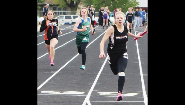 From the left, Sydney Copeland of Absarokee, Jocelyn Ott of Reed Point-Rapelje and Rayna Laakso of Park City at the finish line in the girls 4-by-100 relay.