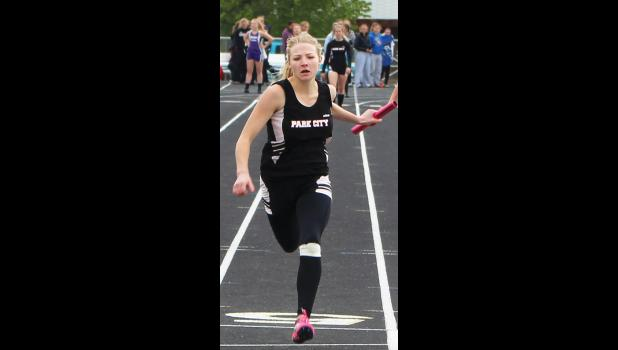 Park City's Rayna Laakso completes the 4-by-100 relay at the May 13 district tournament in Laurel.