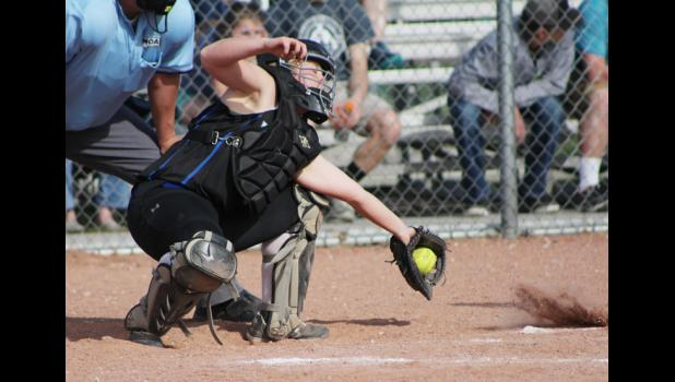 Catcher Shelby McMillan stops a wild pitch.