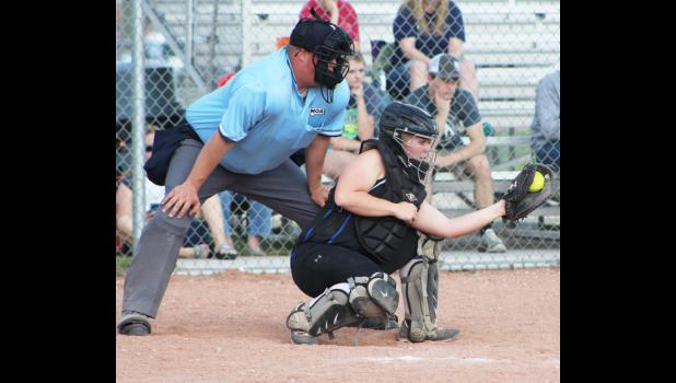 Catcher Shelby McMillan catches a pitch.