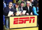 """From the left, Noah Daniels, Ethan Kane, Thomas Gransbery and Preston Fink channel ESPN sports announcers at last Thursday Columbus High School basketball games. The foursome commentated on the game, made jokes and even held up scorecards as if they were judges. Kane said they plan on more """"broadcasts"""" in the future."""
